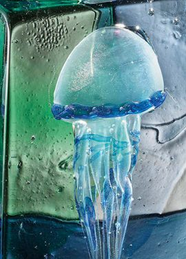 Aquarium made of Murano glass with the submerged technique. Submerged jellyfish in an aquarium with a blue and green bottom.