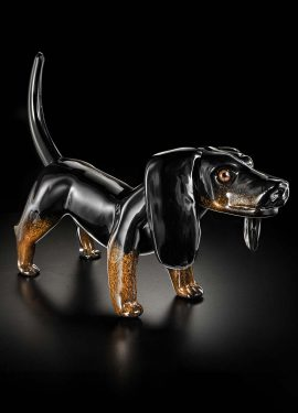 Black dachshund with brown spots, this sculpture measures 52cm in length entirely handmade in Murano glass.