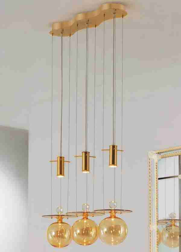 Hanging Suspension Lamps Murano Glass made of blown glass according to ancient Venetian traditions. The shape of the glass is spherical, smooth to the touch, amber