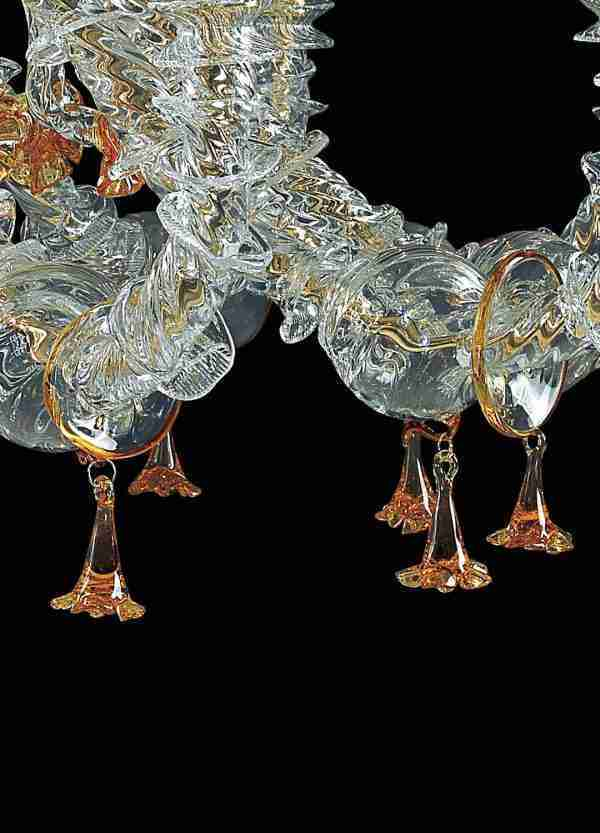 Rezzonico style Murano glass chandelier, one of the Venetian classics, crystal and amber. The pendants give movement and color.
