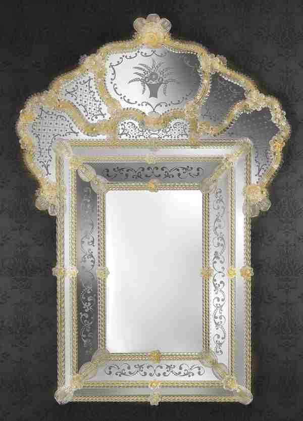 Venetian style mirror a unique work of its kind. Handcrafted by our glass masters, it blends the art of Murano glass with the art of our master engravers.