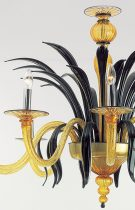 Venetian chandelier made by hand, by our glass masters, in amber colored Murano glass with decorations in black paste.