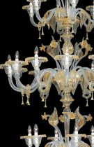 Venetian chandelier handmade, by our glass masters, in Murano glass The colors are crystal with 24K gold decorations ideal for spiral staircases because its shape develops vertically.